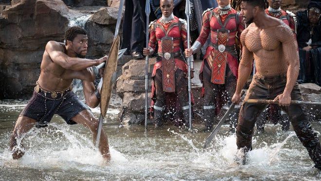 "T'Challa/Black Panther (Chadwick Boseman) and Erik Killmonger (Michael B. Jordan) in ""Black Panther."""