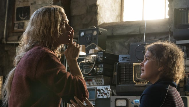 "Emily Blunt plays Evelyn Abbott, and Millicent Simmonds portrays Regan Abbott in ""A Quiet Place."""