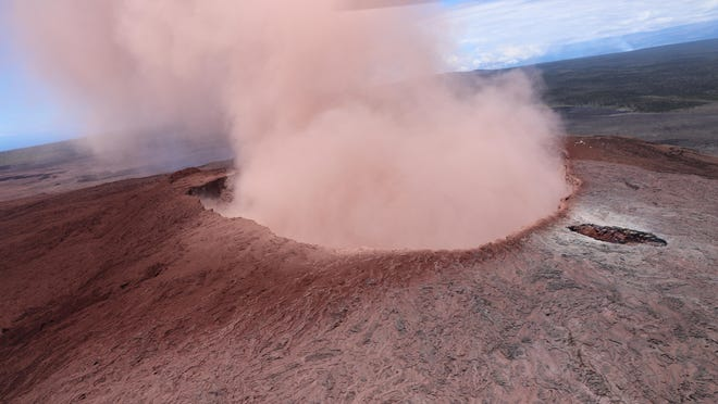 In this photo released by U.S. Geological Survey, a plume of ash rises from the Puu Oo crater on Hawaii's Kilaueaa Volcano, Thursday, May 3, 2018 in Hawaii Volcanoes National Park. Hawaii's Kilauea volcano erupted Thursday, sending lava shooting into the air in a residential neighborhood and prompting mandatory evacuation orders for nearby homes. Hawaii County said steam and lava poured out of a crack in Leilani Estates, which is near the town of Pahoa on the Big Island. (U.S. Geolgogical Survey via AP)