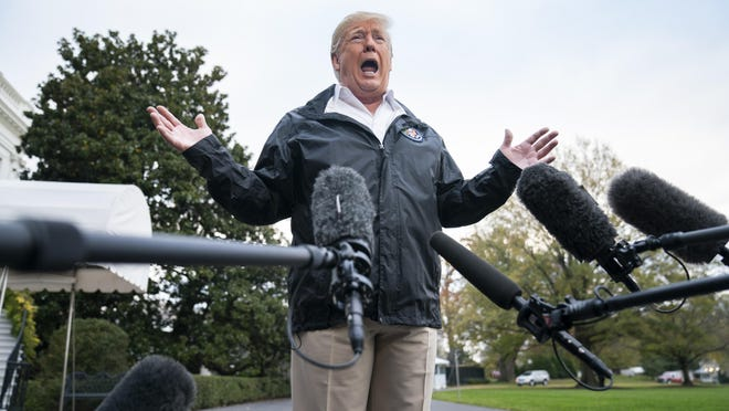 President Donald Trump speaks to the media before departing the White House for California, where he is scheduled to view damage from the state's wildfires on Saturday in Washington, DC.