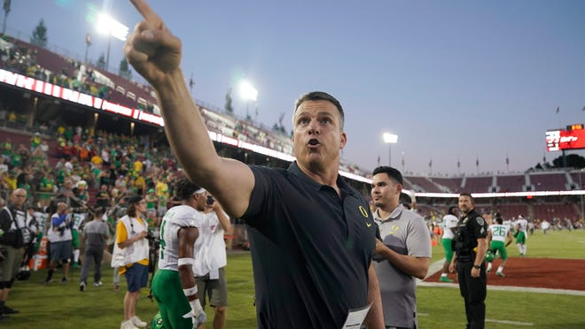 Oregon head coach Mario Cristobal points to fans as he walks off the field after an NCAA college football game against Stanford, Saturday, Sept. 21, 2019, in Stanford, Calif. (AP Photo/Tony Avelar)