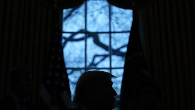 FILE - In this April 24, 2020, file photo President Donald Trump looks on during the signing of a coronavirus aid package to direct funds to small businesses, hospitals, and testing, in the Oval Office of the White House in Washington. (AP Photo/Evan Vucci, File)