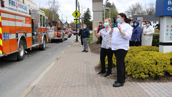 Bon Secours Community Hospital staffers come out to greet first responders.