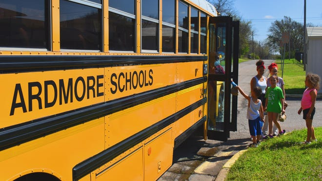 An Ardmore school bus delivers bagged meals to student in March, weeks into the pandemic. Ardmore City Schools on Tuesday released their plan to reopen campuses next month. {File photo]
