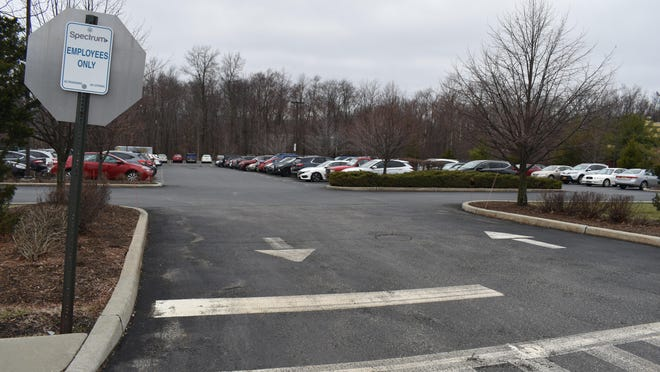 Employees' cars fill Charter Communications' Spectrum call center offices in the Town of Wallkill on Thursday.