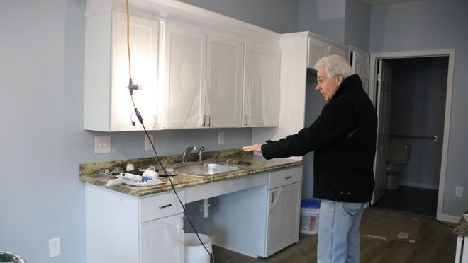 Owner Jim Blanton shows off an ADA-compliant apartment, which includes an open area under the sink that allows the  occupant to be there with a wheelchair.