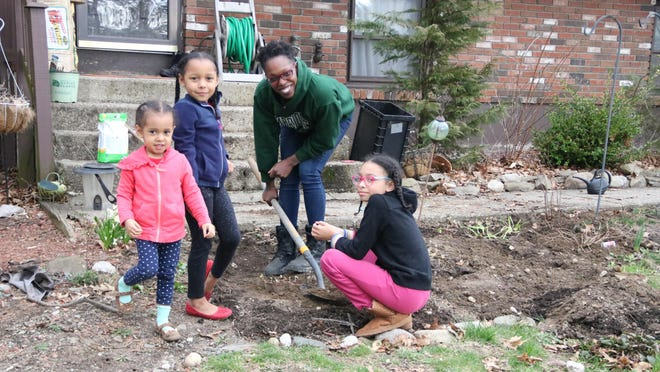 Arina Soler plants a garden with her daughters, Belen, 3; Amara, 5; and Bella, 10, at their home in Otisville.