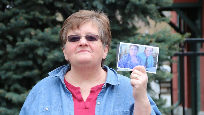 Donna Decker of Glen Spey holds a photo of herself and her late husband, John, who died March 31 of coronavirus.