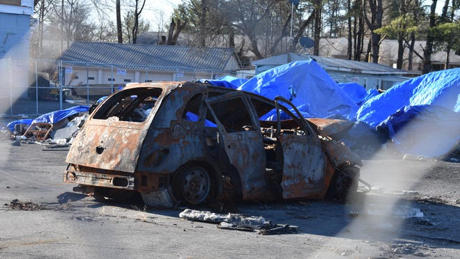 The rubble that was the 613 Automotive Group in Ellenville, including this burned-out car, remains on the site eight months after a fire destroyed the business while an HBO miniseries was being filmed there. Cleanup of the site, which contains asbestos, is scheduled to begin next week.