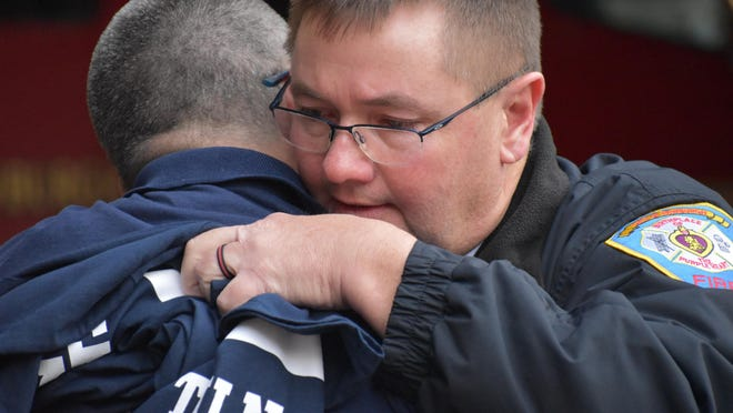 City of Newburgh acting fire Chief Terry Ahlers hugs a colleague while saying his goodbyes to the department after 20 years of service. Ahlers retired Thursday afternoon.