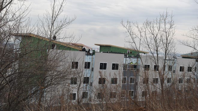 Workers on the rooftops of a hotel under construction off Route 211 in the Town of Wallkill. This is one of four hotels being built in the town, which currently has eight hotels.
