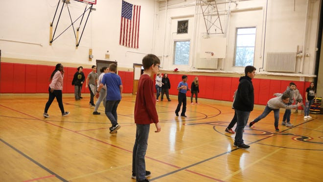 Some students at the Galactic Spectacular celebration played games in the gym.