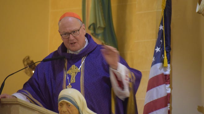 Cardinal Dolan talks to the people about the merge.