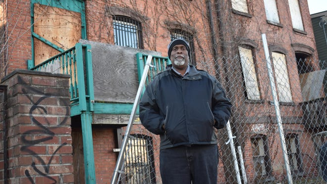 Newburgh Ministry Executive Director Colin Jarvis stands in front of 17 Johnston St., where the ministry is planning to expand its housing services to develop 30 studio low-income apartment units.
