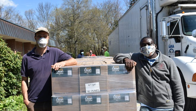 Commercial Horticulture Educator and Organic Grower, Erik Schellenberg and Food Safety Educator, Nathaniel Lartey at the regional distribution in Millbrook. Orange County Extension Educators distributed hand sanitizer and washable face masks to local farm workers on May 8 and May 9.