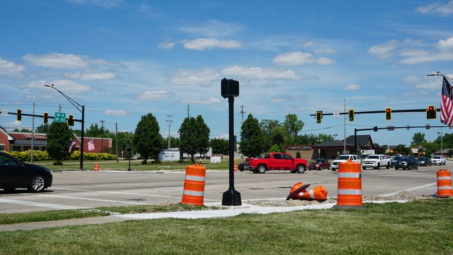 Cars pass through the intersection of Routes 14 and 43 on June 29. The intersection recently got new traffic lights and a new trafic pattern.