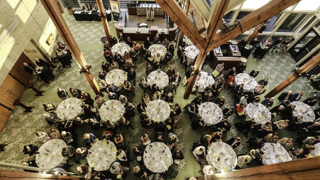 A bird's eye view of the November 2019 Business Recognizing Arts Vision and Achievement breakfast in the Hult Center Lobby.
