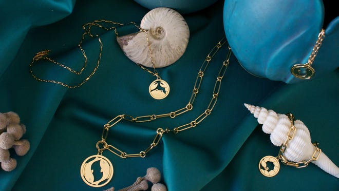 The zodiac collection of pendants by Aurelia Demark. Pieces are handcrafted from 18-karat yellow gold with precious stones and can be engraved.