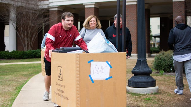 Nick Comella moves out of Presidential Village II for spring break Friday, March 13, 2020, with the help of his parents, Lori and Dennis Comella, at the University of Alabama. UA on Monday released details of plans for students to return for fall classes, which are scheduled to begin Aug. 19.