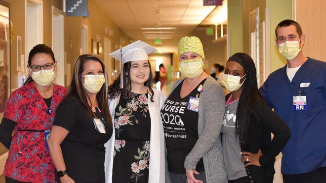 Incoming high school senior and cancer warrior Hani Atkins, of Apple Valley, with her nursing team from Kaiser Permanente in Fontana.