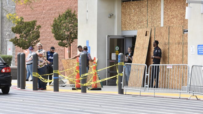 Employees at the Walmart on Palmdale Road in Victorville work to block the entrance after the store closed Monday, June 1, 2020. City officials in Barstow and Adelanto declared local emergencies on Monday and set curfews in response to civil unrest following the May 25, 2020, death of George Floyd in Minneapolis, Minnesota.