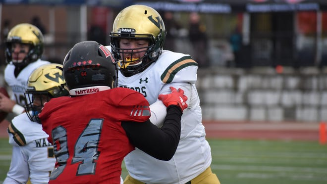 West Branch graduate Ian Sharp blocks a defender during a Wayne State (Mich.) game in 2019.