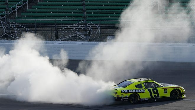 Brandon Jones celebrates his Saturday victory at Kansas Speedway.