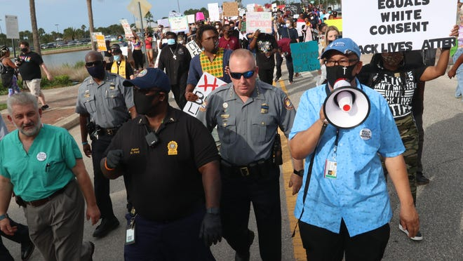 Daytona Beach Police Chief Craig Capri marches with protesters in Daytona Beach on June 11, 2020. Protests occurred nationwide following the death of George Floyd who died while being restrained by Minneapolis police on May 25, 2020.