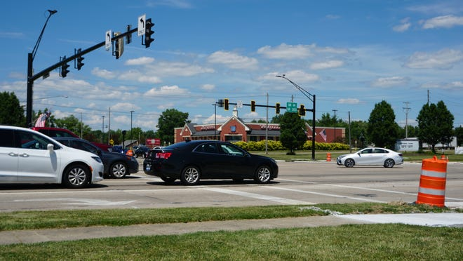 Cars pass through the intersection of Route 14 and 43 on Monday. The intersection has new traffic lights and a new traffic pattern as part of a city-wide project.