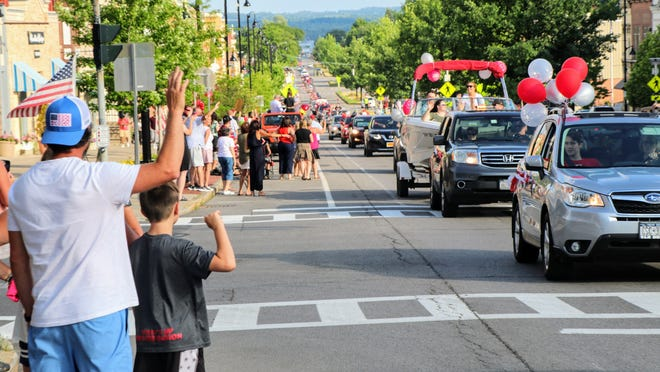 Members of the Canandaigua Academy Class of 2020 make their way up Main Street as part of graduation day activities on Sunday.