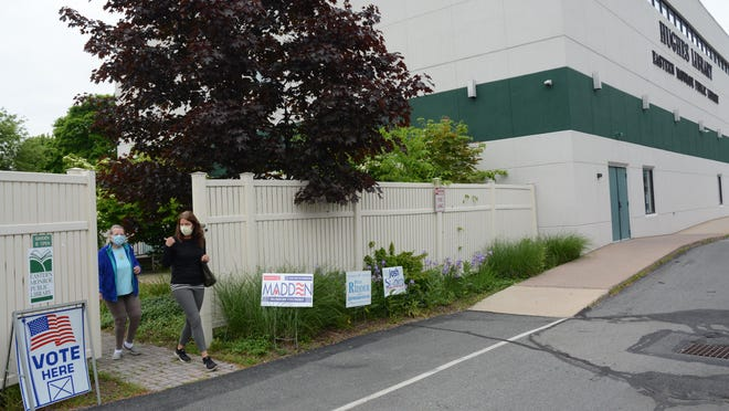 Tarah Probst, right, the mayor of Stroudsburg, and her mother Lois (Kammer) Pugh leave Hughes Library on Route 611 in Stroudsburg after casting their votes Tuesday morning.