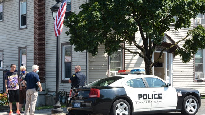 Bystanders watch as police investigate the area of lower Main Street in Stroudsburg on Monday, July 27, 2020 after reports of a stabbing in the area.