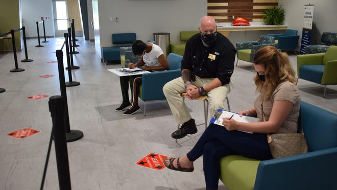 Bill Bondurant, Craven CC director of Advising and Counseling, assists students with registering for classes while following safety guidelines such as social distancing and wearing face coverings.