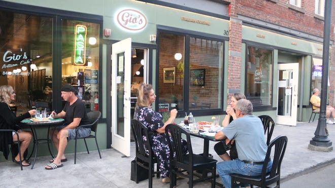 At the table by the street, Barbara Marszalek, left, sat with Art and Anne Horsham, discussing pandemic strategies, among other topics. By the window, Denise and Tom O'Connor ordered ginger sesame salmon. All are from Port Jervis.