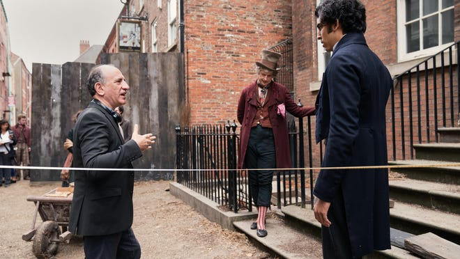 Armando Iannucci gives direction to Dev Patel and Peter Capaldi.