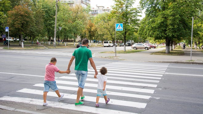 Be sure to follow safety laws and rules when crossing the road while out walking.