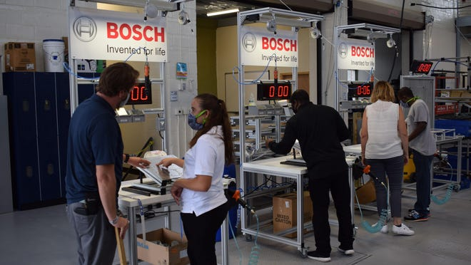 Students in Craven CC's new Manufacturing Career Pathway program receive hands-on training and one-on-one instruction on a mock BSH Home Appliances assembly line. The program, which takes place at the Volt Center, will focus on specific training needed to fill immediate job openings at local manufacturer BSH.