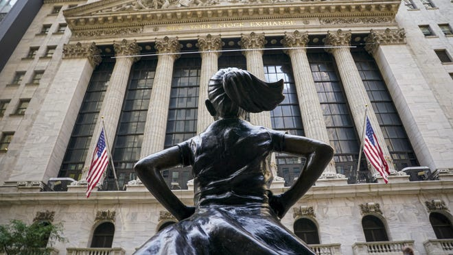 The 'Fearless Girl' bronze sculpture looks toward the New York Stock Exchange from its roadside perch on Tuesday, Aug. 25, 2020, in New York.