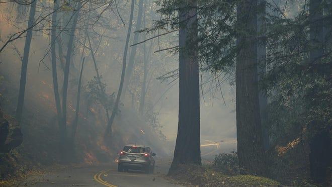 The CZU August Lightning Complex Fire continues to burn Tuesday near Bonny Doon, Calif.