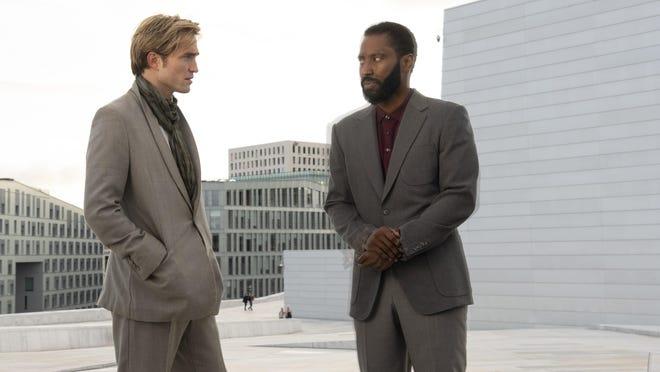 "Robert Pattinson, left, and John David Washington star in the movie ""Tenet."""