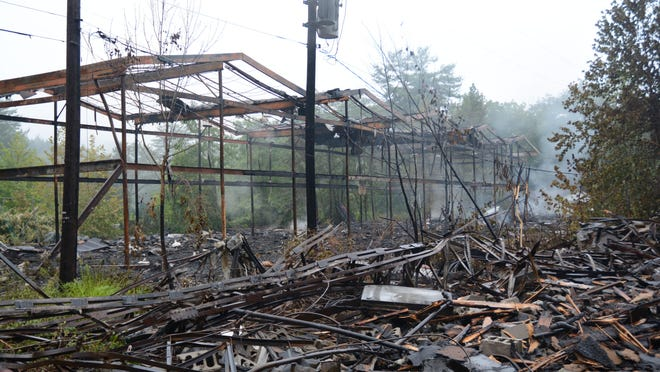 Smoke rises from a burned out portion of the abandoned Penn Hills Resort on Route 191/447 in Stroud Township Wednesday morning.