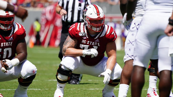 Topsail graduate Joe Sculthorpe lines up for a play during N.C. State's 2019 game against East Carolina.