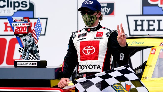 Brandon Jones (19) poses for a photo after winning the NASCAR Xfinity Series auto race Saturday, Sept. 5, 2020, in Darlington, S.C.