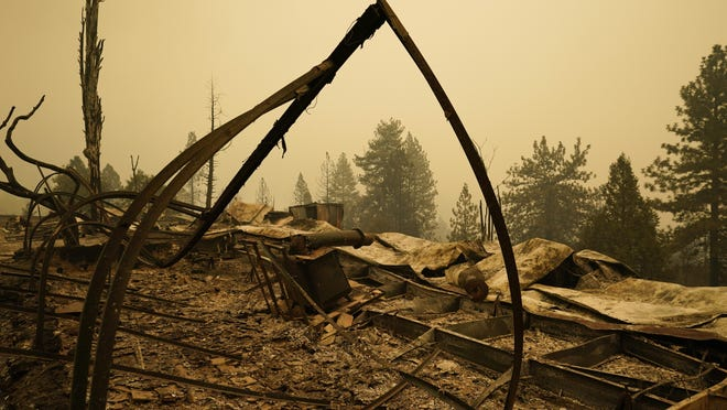 Property is left in ruins after the Creek Fire passed through Tuesday, Sept. 8, 2020, in Tollhouse, Calif.