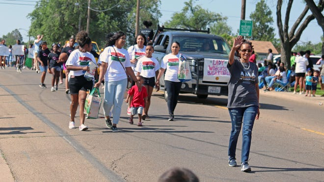 Amarillo City Council member Freda Powell (gray shirt) shows her support by walking in the 2019 Juneteenth Parade.