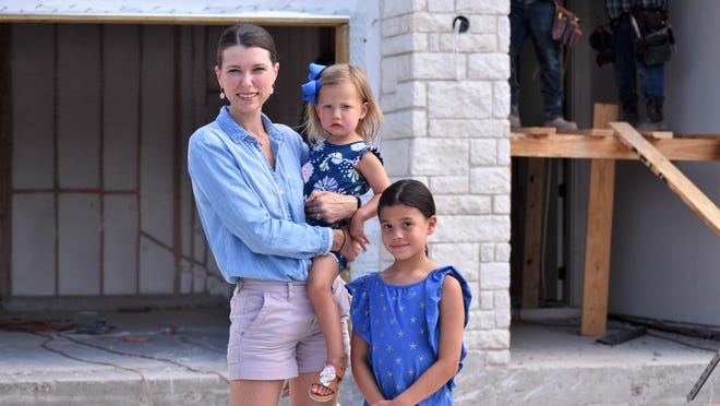 Sabrina Soper and her daughters Sienna, 7, and Sloan, 2, see the construction progress on their Rough Hollow home Monday. After recently relocating to the Lake Travis area from California, Soper is looking for an education pod for her Sienna since the Lake Travis school district won't provide in-person learning until after Labor Day at the earliest.