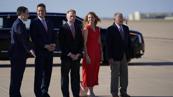 From left, Mayor G.T. Bynum, Lt. Gov. Matt Pinnell, Sen. James Lankford, R-Okla., Cindy Lankford, and Sen. Jim Inhofe, R-Okla., wait for President Donald Trump to arrive at Tulsa International Airport on Saturday, June 20, in Tulsa.