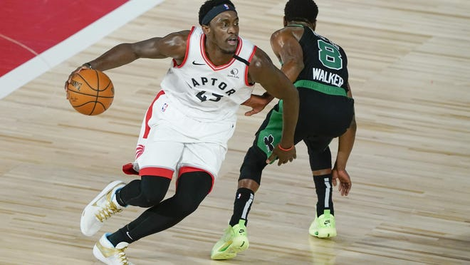 The Celtics' Kemba Walker, right, who tweaked his knee while guarding the Raptors' Pascal Siakam, left, during Sunday's game, reported no ill effects during practice on Monday.