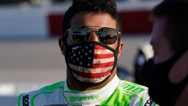 Bubba Wallace speaks to crew before a NASCAR Cup Series auto race Sunday, Sept. 6, 2020, in Darlington, S.C. (AP Photo/Chris Carlson)