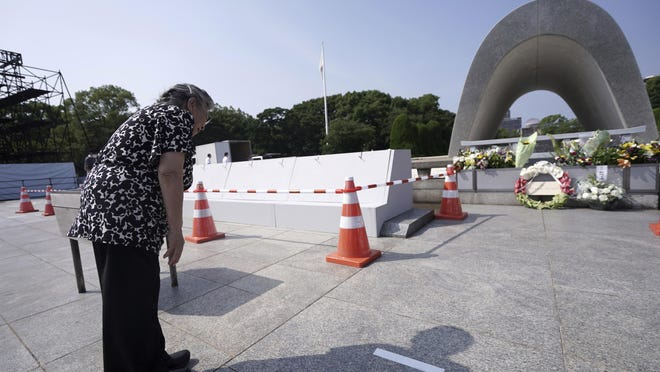 "Koko Kondo prays at the cenotaph for the atomic bombing victims near Hiroshima Peace Memorial Museum in Hiroshima, western Japan, Wednesday. Kondo was determined to find the person who dropped the atomic bomb on Hiroshima, western Japan, the person that caused the suffering and the terrible facial burns of the girls at her father's church - and then square off and punch them in the face. Ten-year-old Kondo appeared on an American TV show called ""This is Your Life"" that was featuring her father, Rev. Kiyoshi Tanimoto, one of six survivors profiled in John Hersey's book ""Hiroshima."""